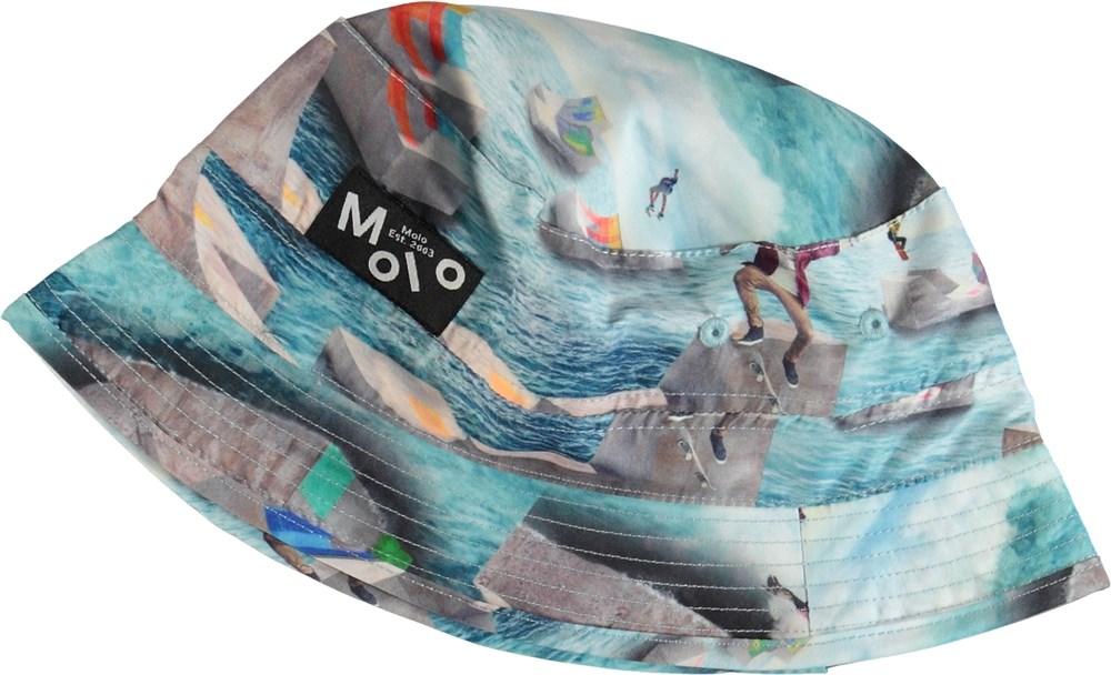 Niks - Ocean Skate - Solhatt med skateboardåkare
