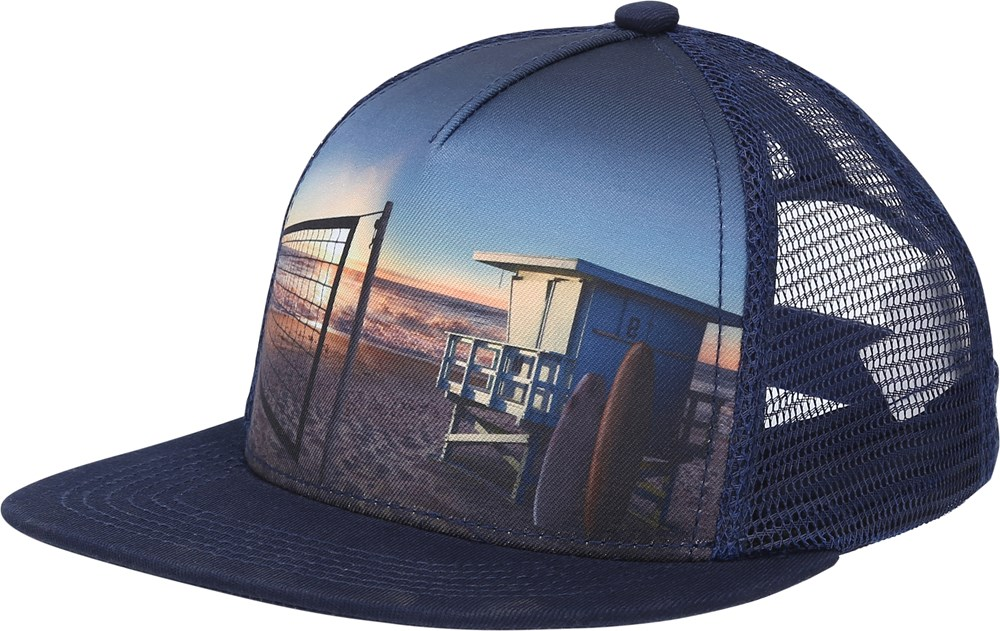 Big Shadow - On The Beach - Cap with a beach print.