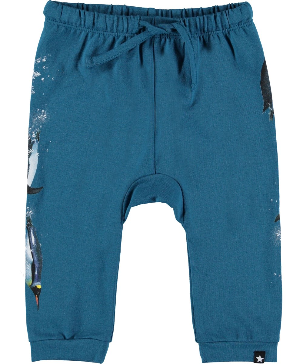 Sabbe - Frozen Deep - Blue baby trousers with penguins.