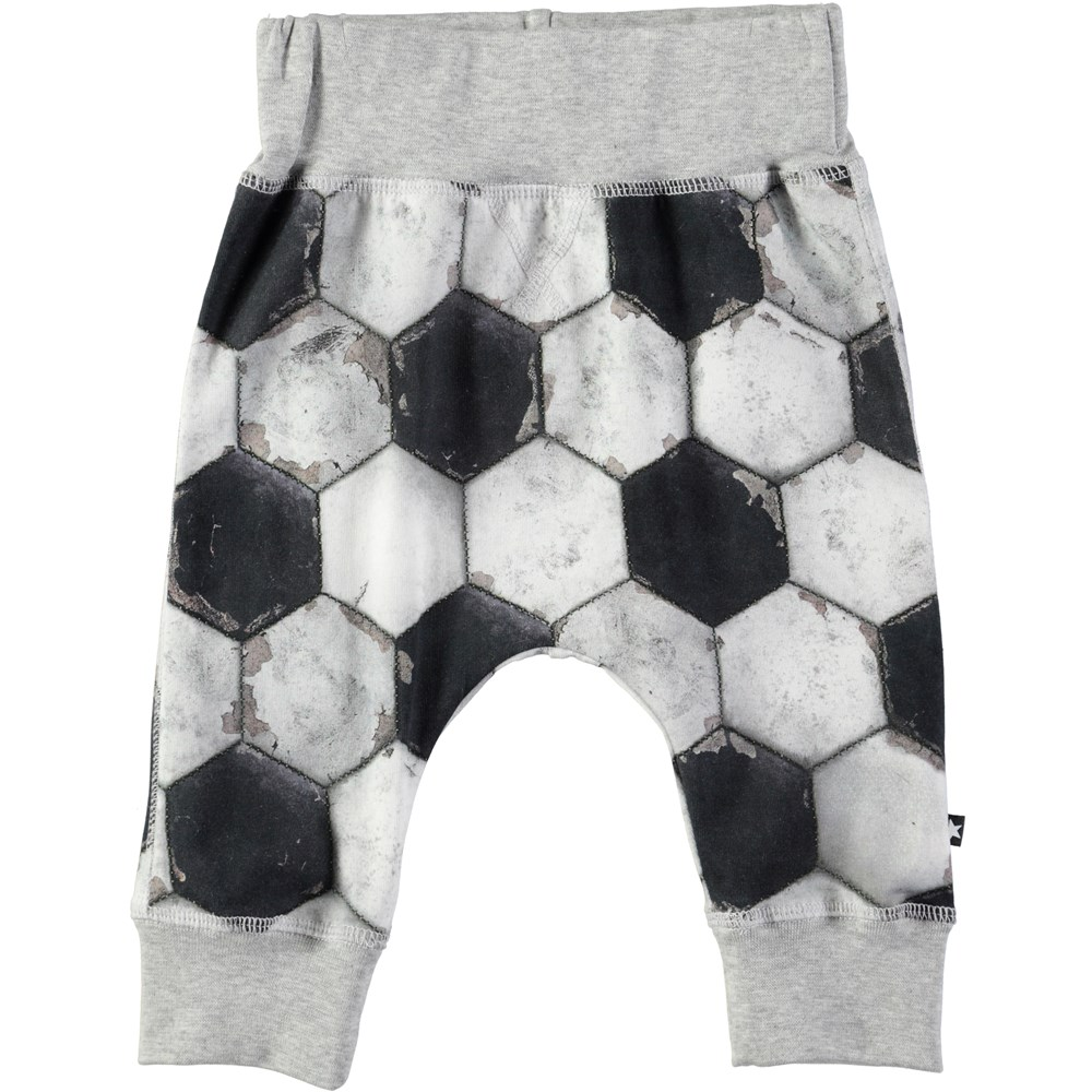 Sammy - Football Structure - Roomy baby trousers with football print
