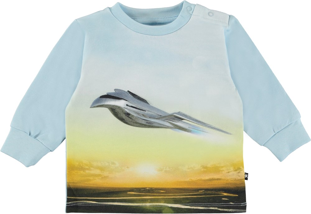 Eloy - Flying - Light blue organic baby top with airplane