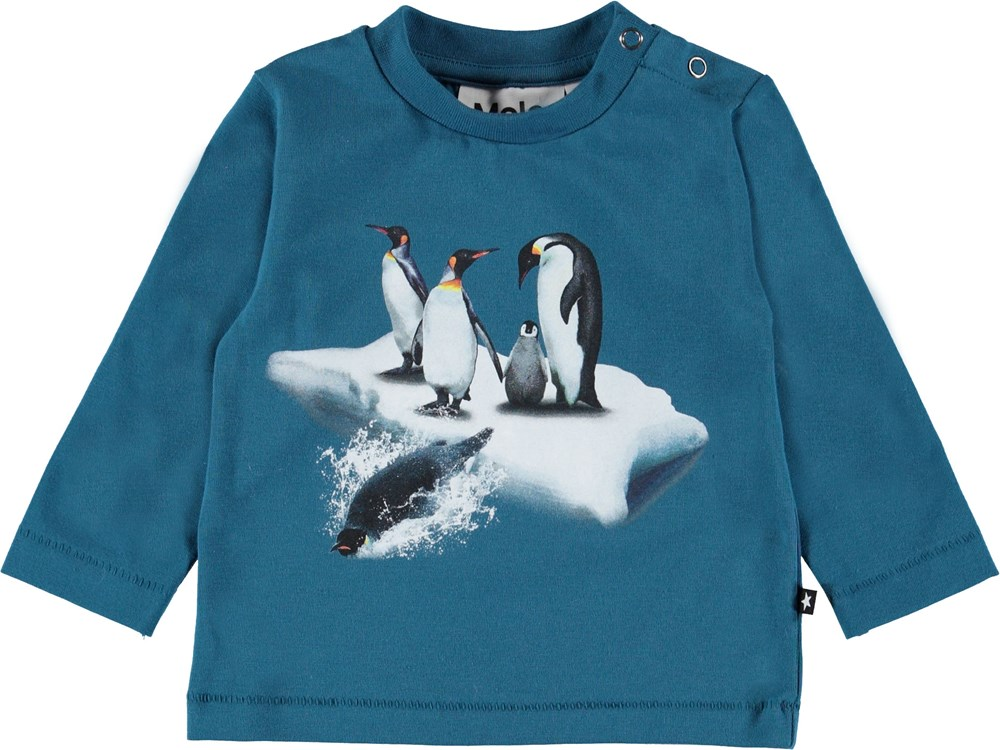 Enovan - Frozen Deep - Blue baby top with penguins.