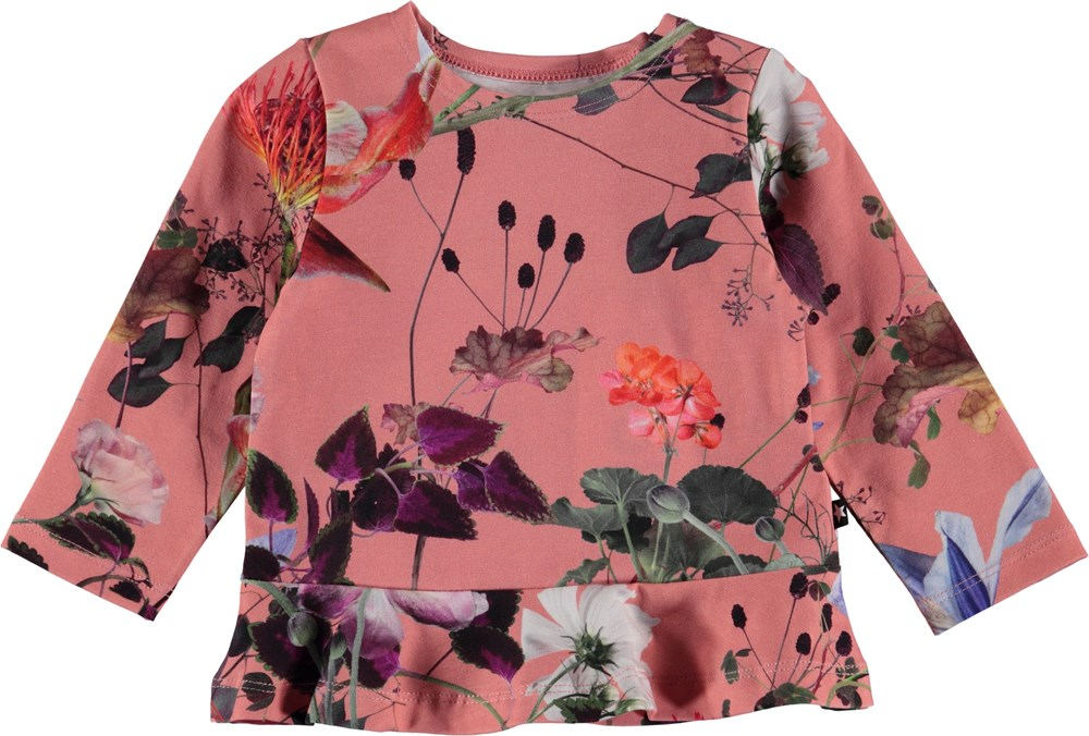 Elisabeth - Flowers Of The World - Blommig baby blus med peplum.