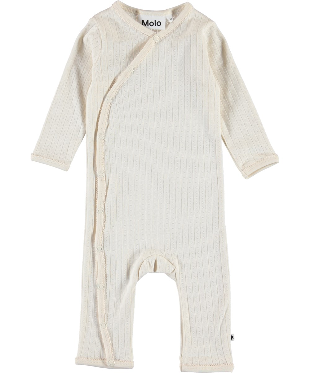 Flora - Pearled Ivory - Organic baby romper in needle-out pattern
