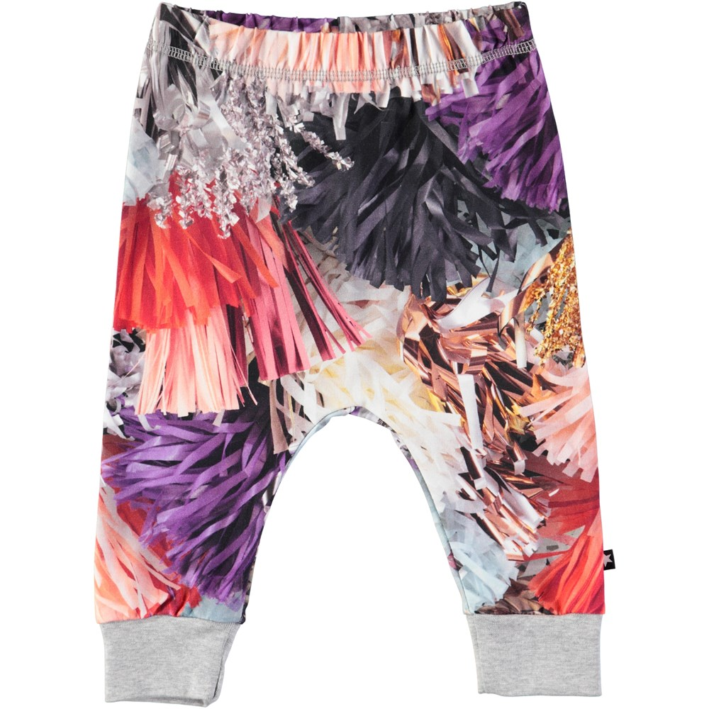 Simone - Celebration - Baby trousers with digital print of festive tassles