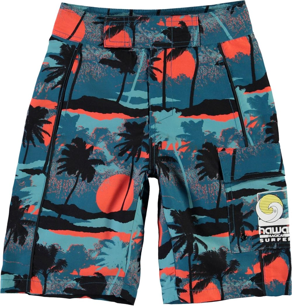 Natan - Palm Trees Blue - UV lange badeshorts med blå palmer