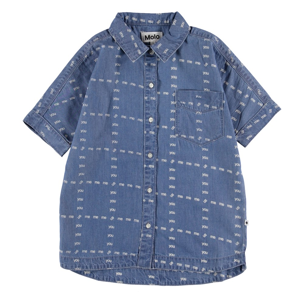 Raphaella - US! Blue - Blue denim shirt with words.