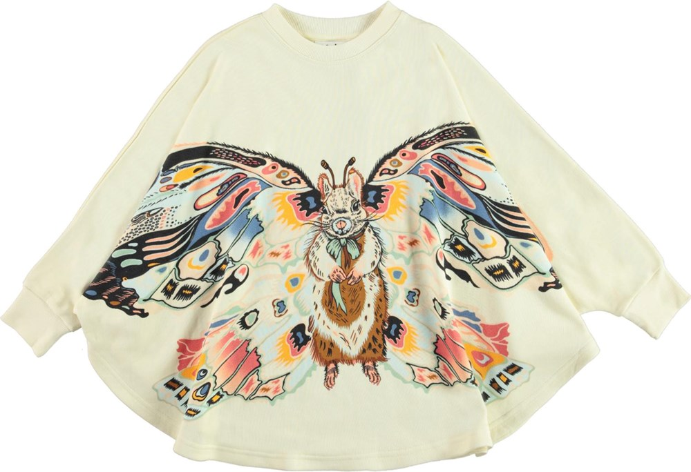 Marcella - Fluffy Wings - Light coloured poncho with squirrel print