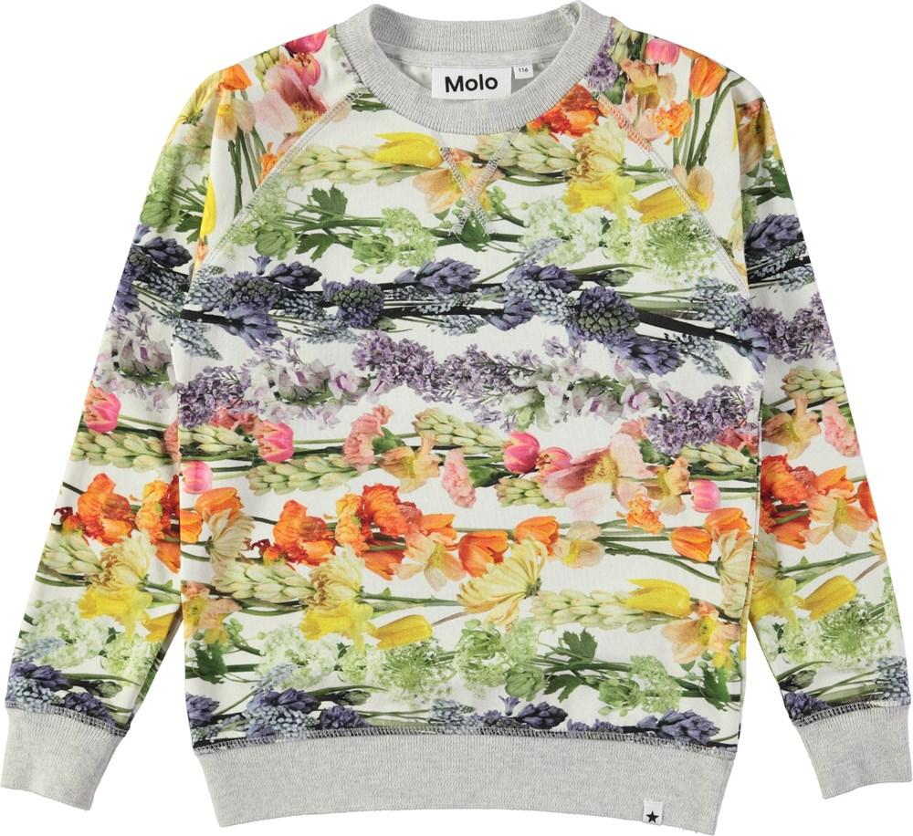 Raewyn - Rainbow Bloom - Top in a sweatshirt look with digital flower print