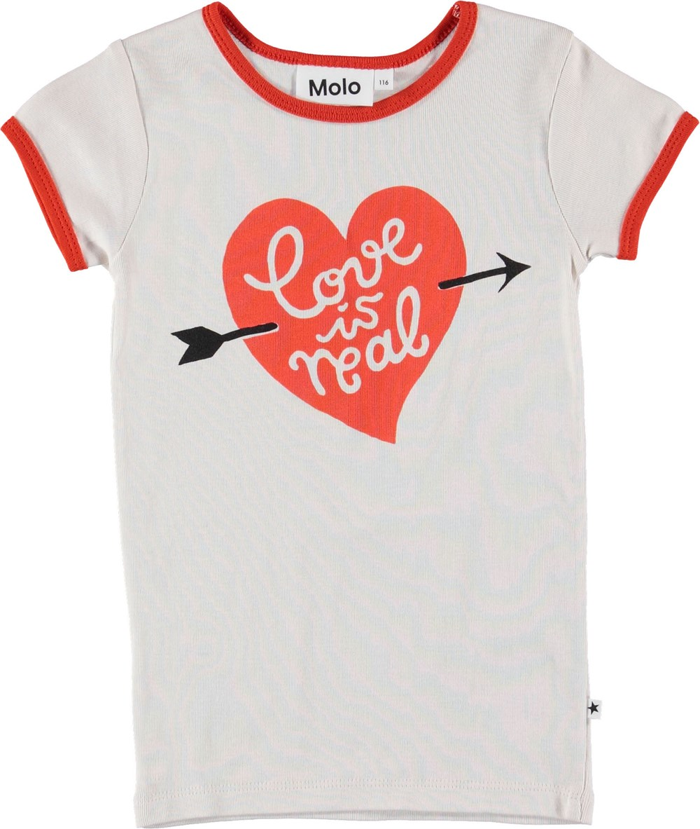Rhiannon - Parchment - White t-shirt with red heart.