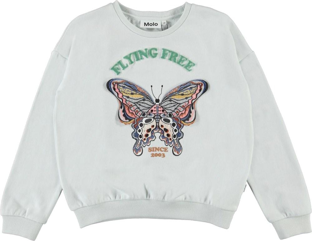 Maja - Flying Free - Lyseblå sweatshirt med broderet sommerfugl