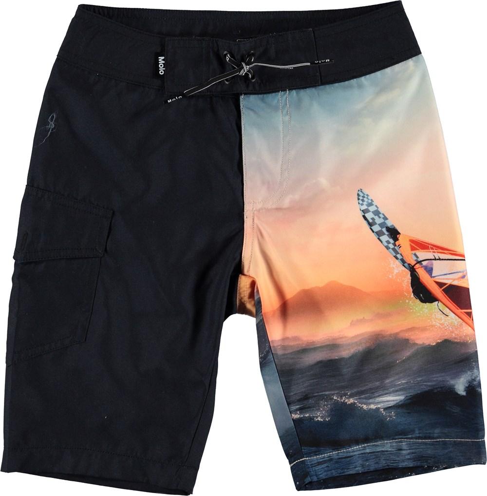 Nalvaro - Point Break - Long UV swim trunks with surf print.