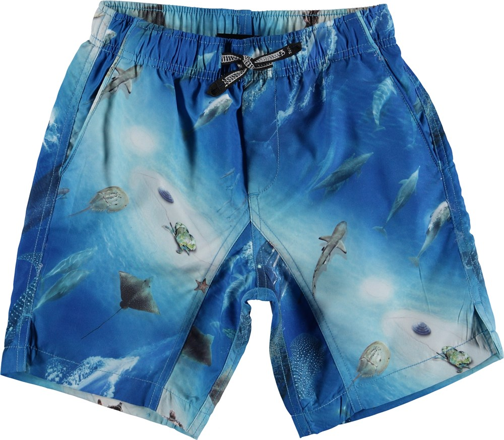 Nario - Above Ocean - Long UV swim trunks with ocean print