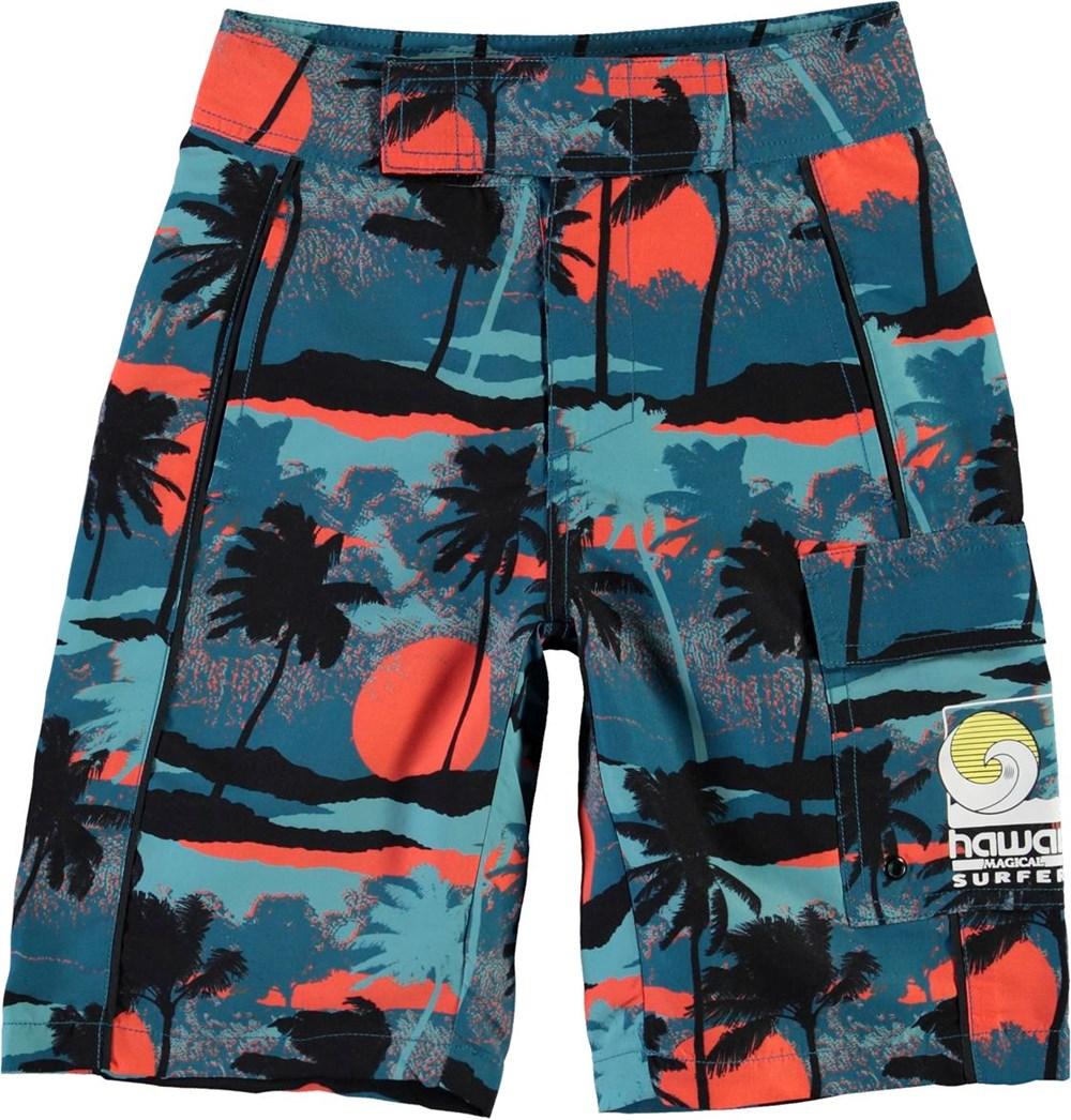 Natan - Palm Trees Blue - Long swim trunks with blue palm trees