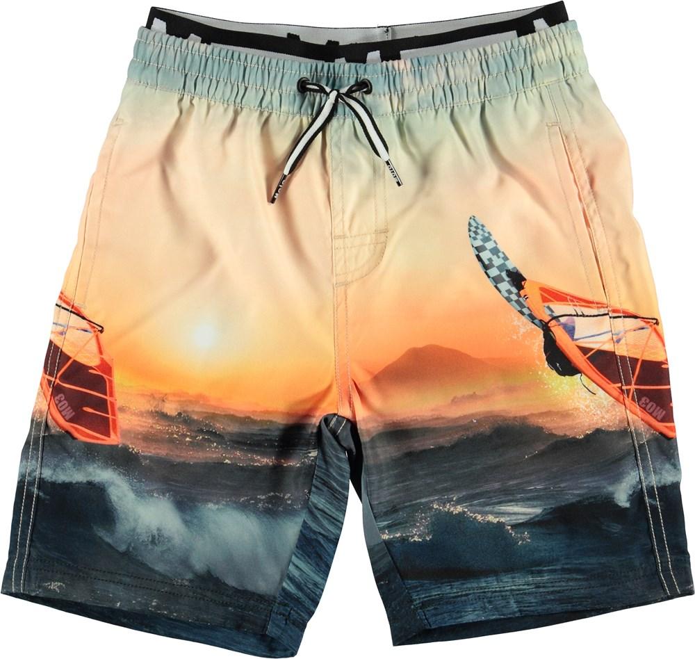 Neal - Point Break - Long UV swim trunks with surfer print