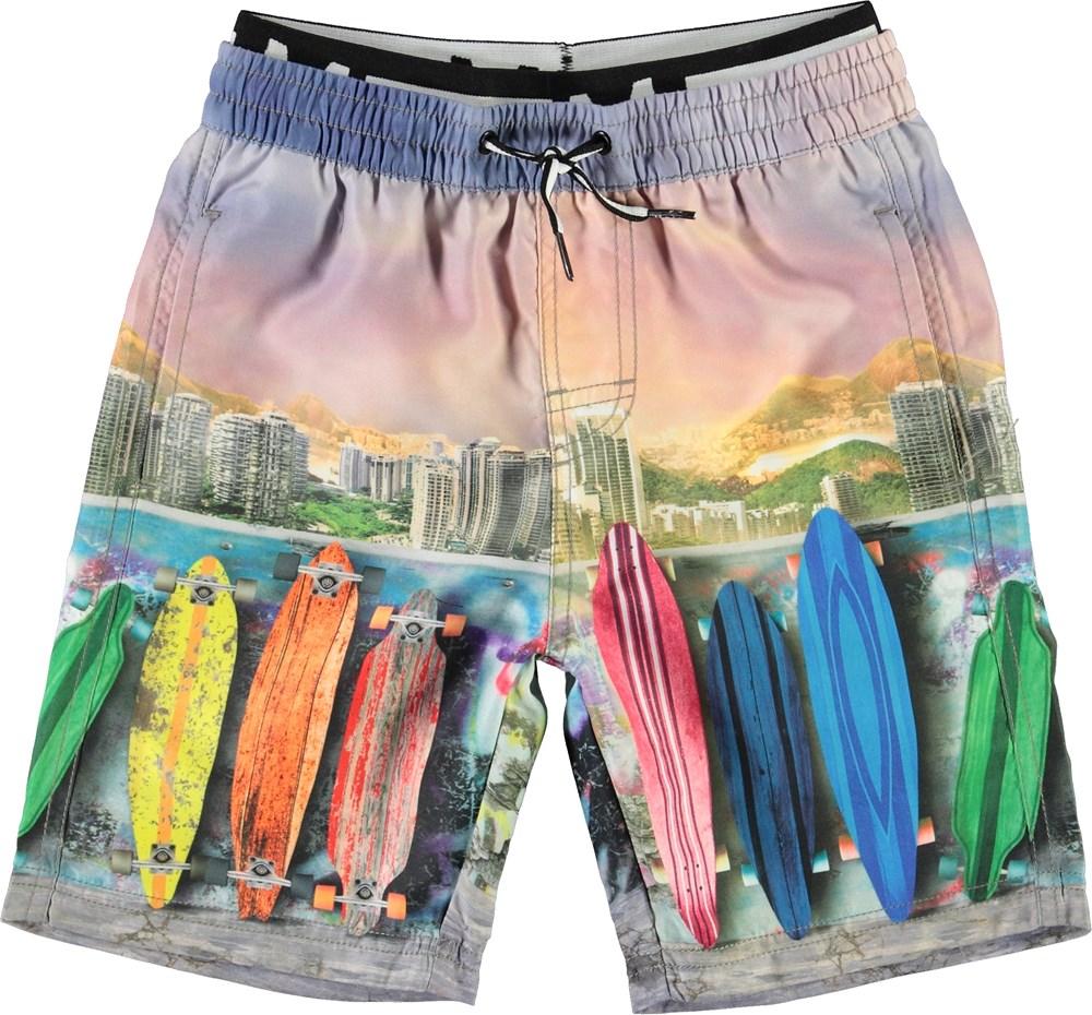 Neal - Rainbow Boards - Long UV swim trunks with surfboard print