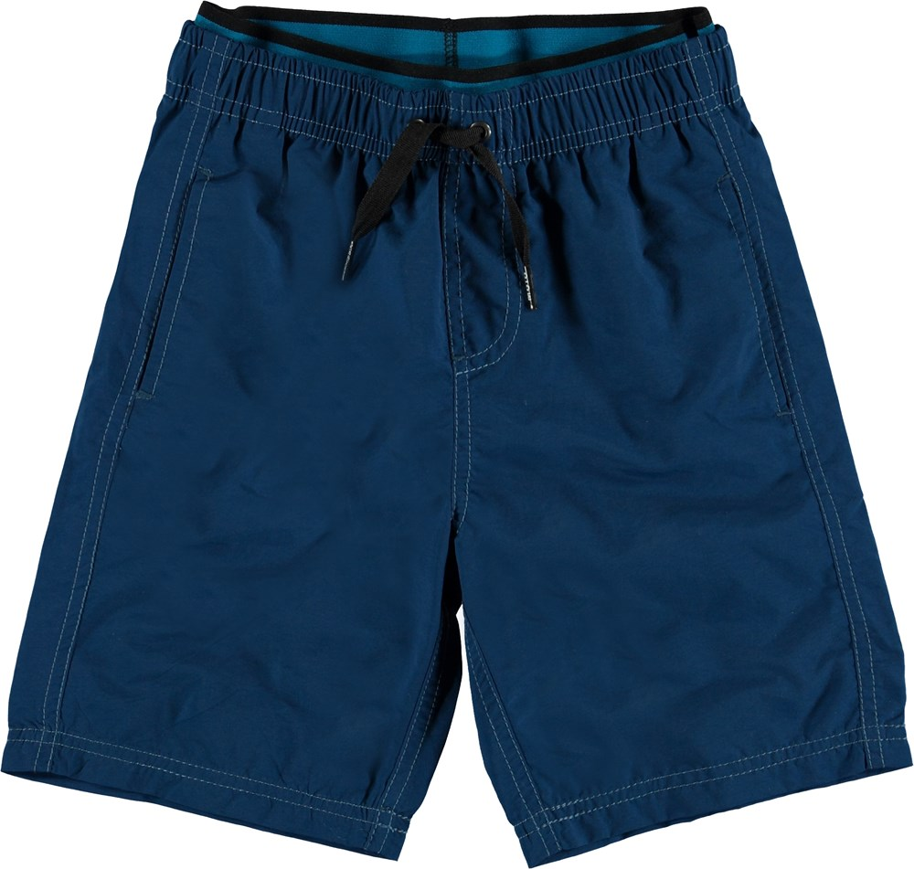 Neal Solid - Blue Cave - Long, dark blue UV swim trunks