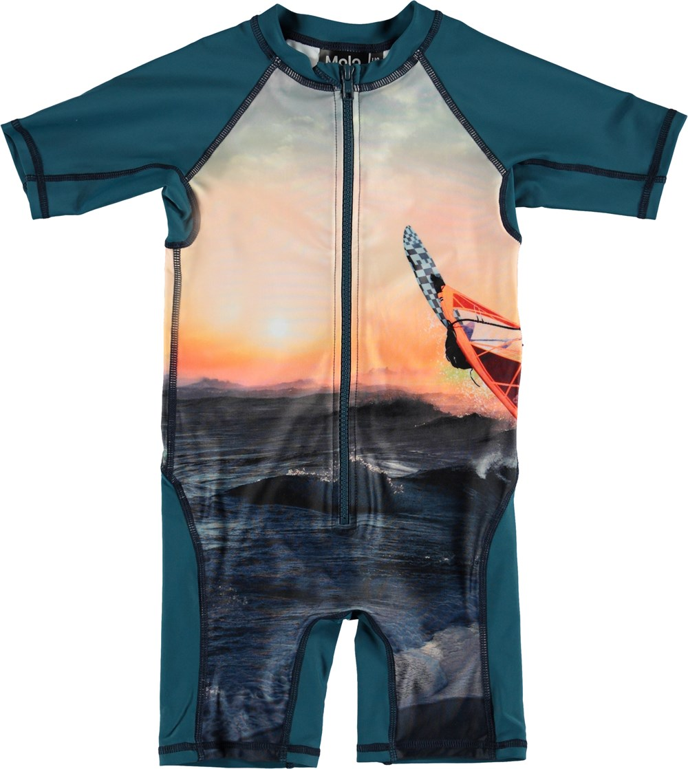 Neka Placed - Point Break - Blue UV swimsuit with surfer print