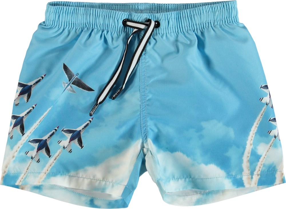 Niko - Air Show - Light blue swim trunks with airplane