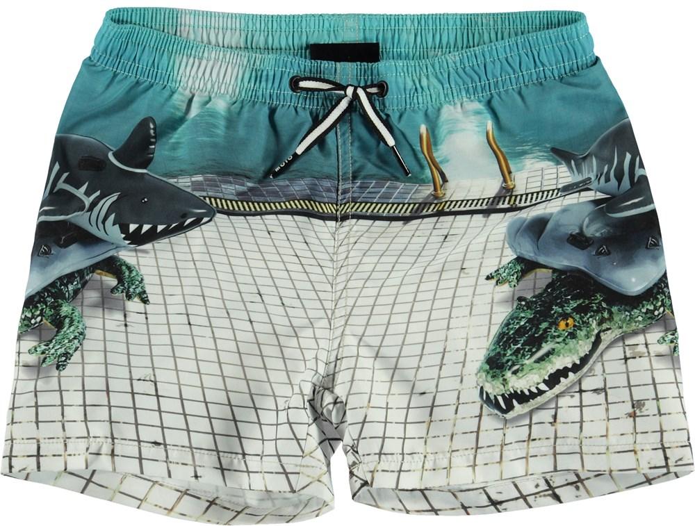 Niko - Pool Side - UV swim trunks with animal float print