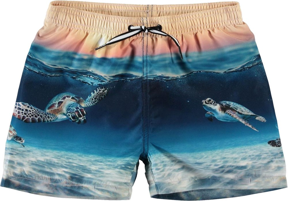 Niko - Sea Turtle Sunset - UV swim trunks with turtles
