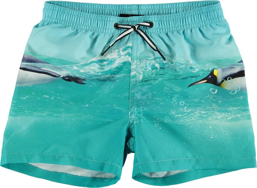 Niko - The Penguin - UV swim trunks with penguin print